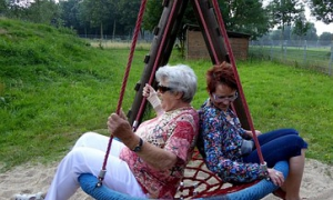 2 ladies on a swing together