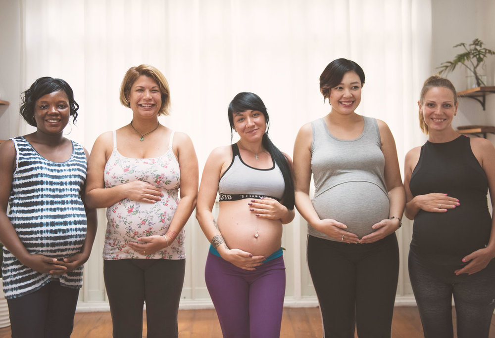 a row of pregnant women together